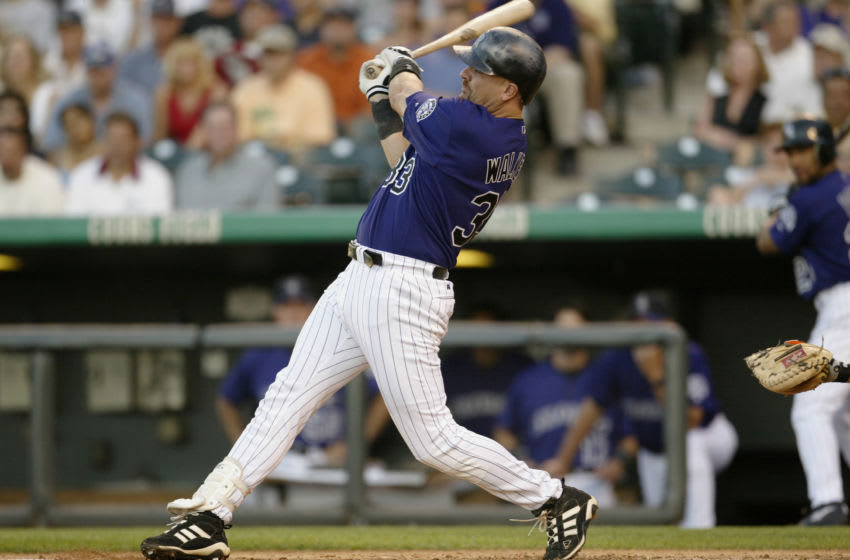 DENVER - JULY 9: Right fielder Larry Walker #33 of the Colorado Rockies hits a two-run double against the San Francisco Giants during the MLB game at Coors Field on July 9, 2003 in Denver, Colorado. The Rockies won 11-7. (Photo by Brian Bahr/Getty Images)