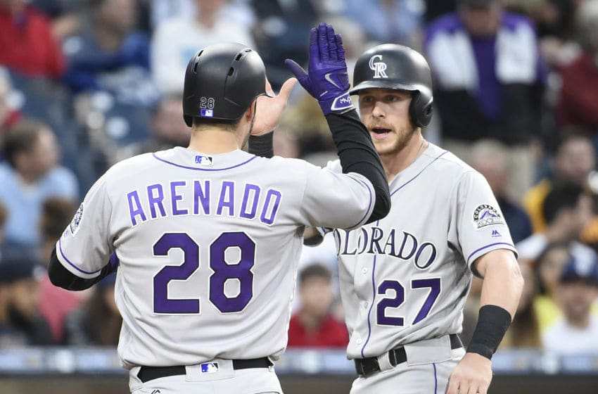 SAN DIEGO, CALIFORNIA - JUNE 5: Nolan Arenado #28 of the Colorado Rockies is congratulated by Trevor Story #27 after he hit a two-run home run during the fifth inning of a baseball game against the San Diego Padres at PETCO Park on June 5, 2016 in San Diego, California. (Photo by Denis Poroy/Getty Images)