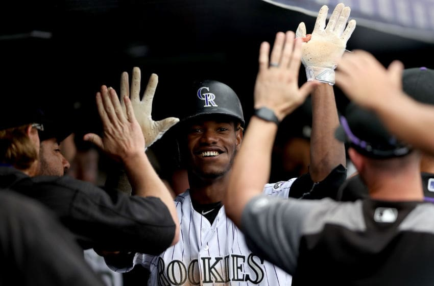 DENVER, CO - AUGUST 06: Raimel Tapia #7 of the Colorado Rockies is cngratulated in the dugout after scoring on a Charlie Blackmon double in the seventh inning against the Philadelphia Phillies at Coors Field on August 6, 2017 in Denver, Colorado. (Photo by Matthew Stockman/Getty Images)