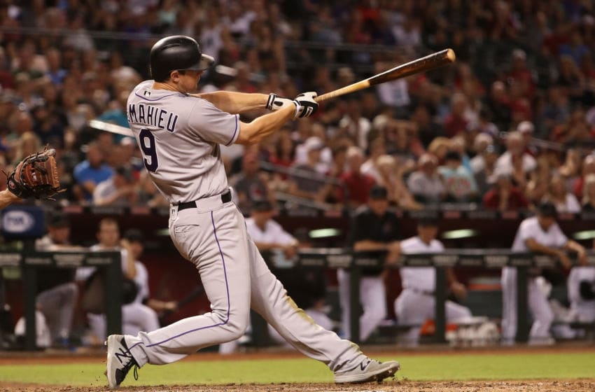 PHOENIX, AZ - SEPTEMBER 12: DJ LeMahieu #9 of the Colorado Rockies hits a single against the Arizona Diamondbacks during the seventh inning of the MLB game at Chase Field on September 12, 2017 in Phoenix, Arizona. (Photo by Christian Petersen/Getty Images)