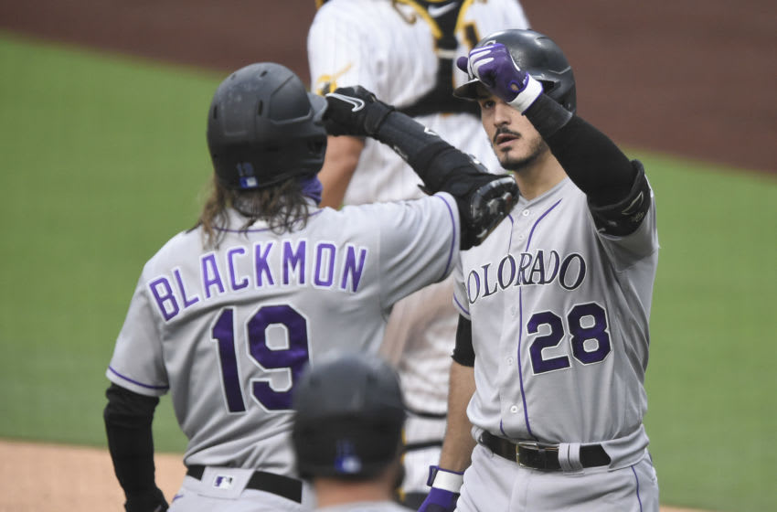 SAN DIEGO, CA - SEPTEMBER 8: Nolan Arenado #28 of the Colorado Rockies is congratulated by Charlie Blackmon #19 after hitting a three-run home run during the first inning of a baseball game against the San Diego Padres at Petco Park on September 8, 2020 in San Diego, California. (Photo by Denis Poroy/Getty Images)
