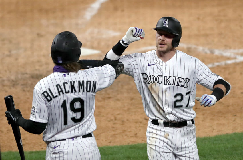 DENVER, COLORADO - JULY 31: Trevor Story #27 of the Colorado Rockies is congratulated by Charlie Blackmon #19 after hitting a solo home run in the seventh inning against the San Diego Padres at Coors Field on July 31, 2020 in Denver, Colorado. (Photo by Matthew Stockman/Getty Images)
