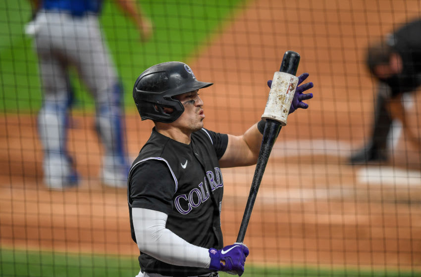 DENVER, CO - AUGUST 14: Tony Wolters #14 of the Colorado Rockies prepares to bat against the Texas Rangers at Coors Field on August 14, 2020 in Denver, Colorado. (Photo by Dustin Bradford/Getty Images)