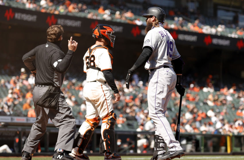 SAN FRANCISCO, CALIFORNIA - APRIL 09: Charlie Blackmon #19 of the Colorado Rockies argues with home plate umpire Ben May #97 after he struck out in the seventh inning against the San Francisco Giants during the Giants home opener at Oracle Park on April 09, 2021 in San Francisco, California. May ejected Blackmon from the game. (Photo by Ezra Shaw/Getty Images)