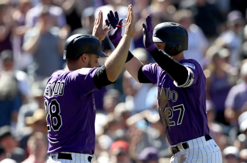 DENVER, CO - SEPTEMBER 13: Trevor Story #27 of the Colorado Rockies is congratulated by by Nolan Arenado #28 as he crosses home plate after hitting a 2 RBI home run in the third inning against the Arizona Diamondbacks at Coors Field on September 13, 2018 in Denver, Colorado. (Photo by Matthew Stockman/Getty Images)