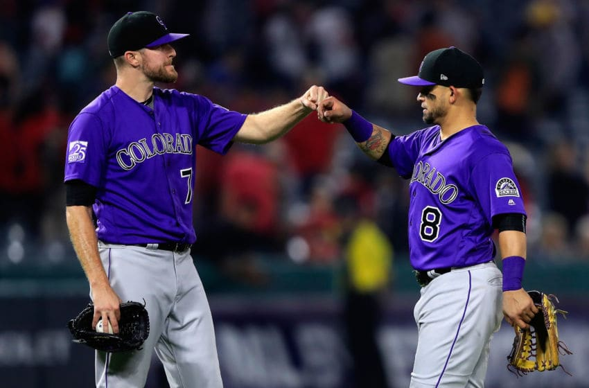 ANAHEIM, CA - AUGUST 28: Wade Davis #71 and Gerardo Parra #8 of the Colorado Rockies celebrate defeating the Los Angeles Angels of Anaheim 3-2 in a game at Angel Stadium on August 28, 2018 in Anaheim, California. (Photo by Sean M. Haffey/Getty Images)