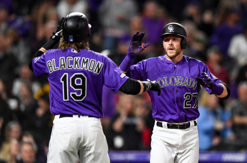 DENVER, CO - APRIL 8: Colorado Rockies shortstop Trevor Story #27 celebrates with center fielder Charlie Blackmon #19 after hitting a fifth inning 3-run homerun against the Atlanta Braves at Coors Field on April 8, 2019 in Denver, Colorado. (Photo by Dustin Bradford/Getty Images)