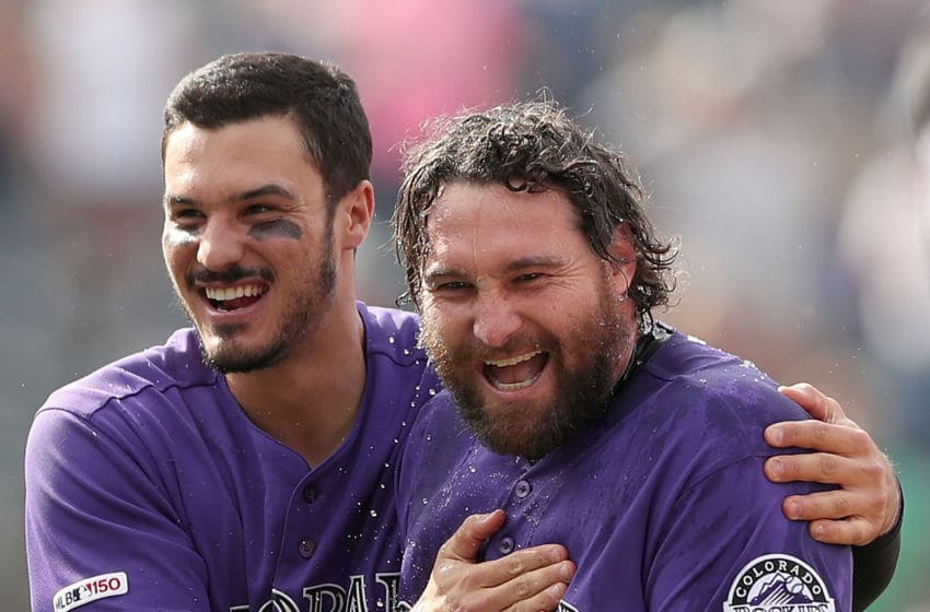 DENVER, COLORADO - MAY 30: Nolan Arenado #28 congratulates Daniel Murphy #9 of the Colorado Rockies after his RBI walk off single in the tenth inning against the Arizona Diamondbacks at Coors Field on May 30, 2019 in Denver, Colorado. (Photo by Matthew Stockman/Getty Images)