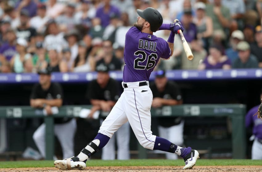 DENVER, COLORADO - JUNE 30: David Dahl #26 of the Colorado Rockies hits a 3 RBI home run in the fifth inning against the Los Angeles Dodgers at Coors Field on June 30, 2019 in Denver, Colorado. (Photo by Matthew Stockman/Getty Images)