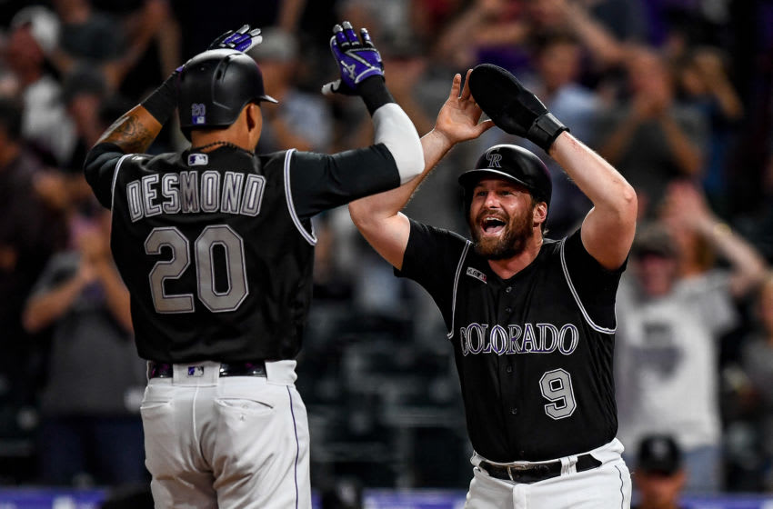 DENVER, CO - JULY 16: Ian Desmond #20 and Daniel Murphy #9 of the Colorado Rockies celebrate scoring on a Desmond home run, tying the game in the ninth inning against the San Francisco Giants at Coors Field on July 16, 2019 in Denver, Colorado. (Photo by Dustin Bradford/Getty Images)