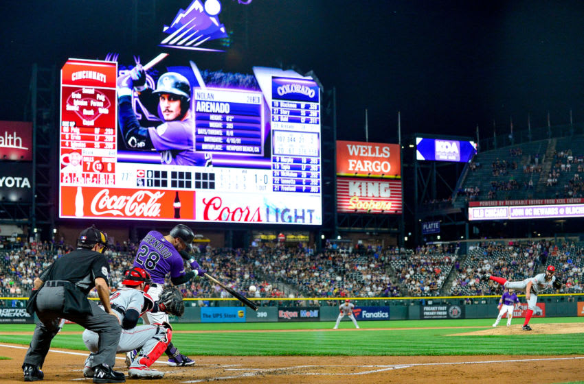 DENVER, CO - JULY 13: Nolan Arenado #28 of the Colorado Rockies hits a first inning 2-run home run against the Cincinnati Reds during a game at Coors Field on July 13, 2019 in Denver, Colorado. (Photo by Dustin Bradford/Getty Images)