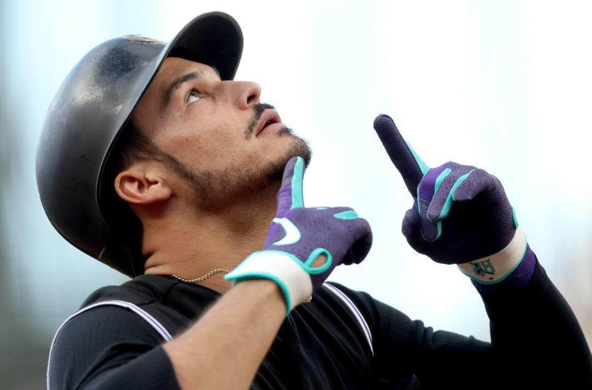 DENVER, COLORADO - MAY 24: Nolan Arenado #28 pof the Colorado Rockies celebrates as he crosses home plate after hitting a solo home run in the first inning against the Baltimore Orioles at Coors Field on May 24, 2019 in Denver, Colorado. (Photo by Matthew Stockman/Getty Images)