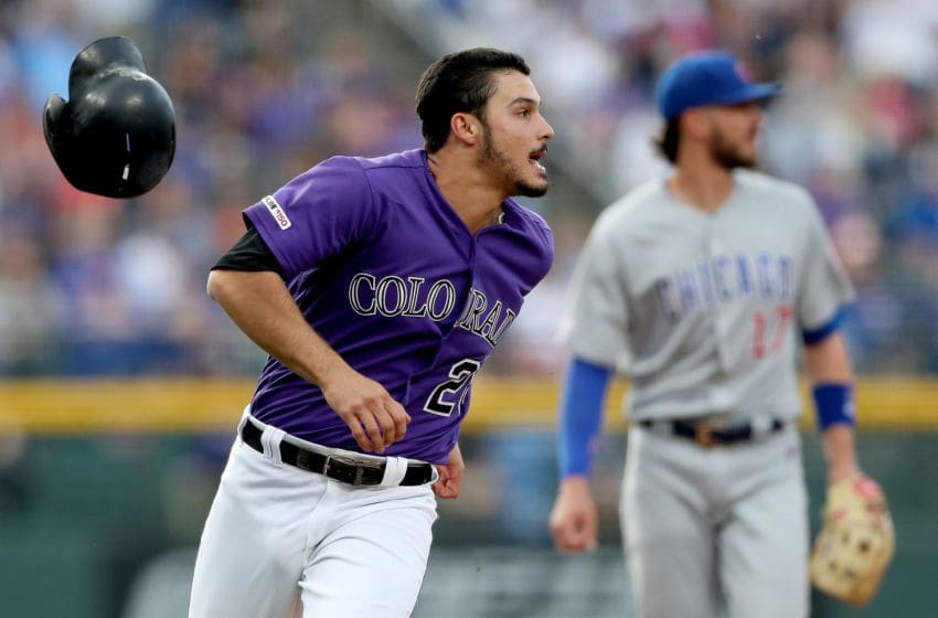 DENVER, COLORADO - JUNE 11: Nolan Arenado #28 of the Colorado Rockies rounds third base to score on a Daniel Murphy 2 RBI double in the first inning against the Chicago Cubs at Coors Field on June 11, 2019 in Denver, Colorado. (Photo by Matthew Stockman/Getty Images)