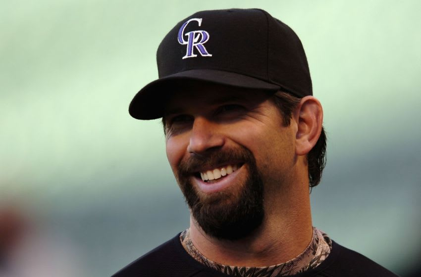 DENVER - OCTOBER 06: Todd Helton #17 of the Colorado Rockies smiles as he warms up before Game Three of the National League Divisional Series against the Philadelphia Phillies at Coors Field on October 6, 2007 in Denver, Colorado (Photo by Steve Dykes/Getty Images)