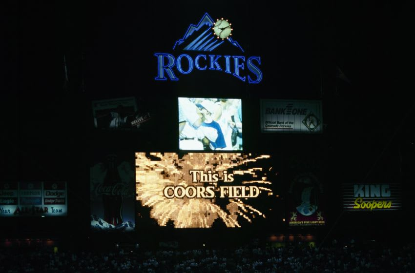 DENVER - JUNE 19: A general view of the scoreboard at night during the game between the Florida Marlins and the Colorado Rockies at Coors Field on June 19, 1995 in Denver, Colorado. (Photo by Nathan Bilow/Getty Images)