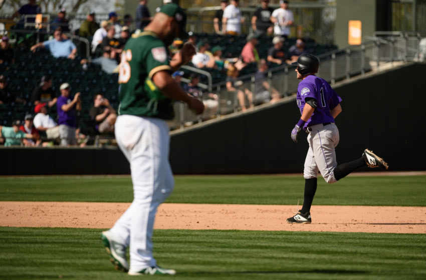 MESA, ARIZONA - MARCH 01: Garrett Hampson #1 of the Colorado Rockies hits a two run home run in the fifth inning of the spring training game against Yusmeiro Petit #36 of the Oakland Athletics at HoHoKam Stadium on March 01, 2019 in Mesa, Arizona. (Photo by Jennifer Stewart/Getty Images)
