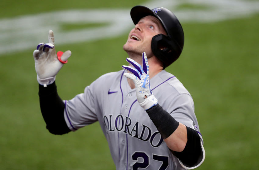 ARLINGTON, TEXAS - JULY 26: Trevor Story (27) of the Colorado Rockies celebrates after hitting a two-run home run in the top of the fourth inning against the Texas Rangers at Globe Life Field on July 26, 2020 in Arlington, Texas. (Photo by Tom Pennington/Getty Images)