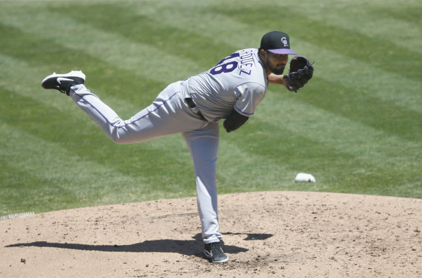 OAKLAND, CALIFORNIA - JULY 29: German Marquez #48 of the Colorado Rockies pitches in the bottom of the third inning against the Oakland Athletics at Oakland-Alameda County Coliseum on July 29, 2020 in Oakland, California. (Photo by Lachlan Cunningham/Getty Images)
