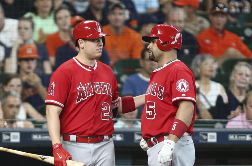 Jun 11, 2017; Houston, TX, USA; Los Angeles Angels designated hitter Albert Pujols (5) talks with first baseman C.J. Cron (24) after hitting a home run during the first inning against the Houston Astros at Minute Maid Park. Mandatory Credit: Troy Taormina-USA TODAY Sports