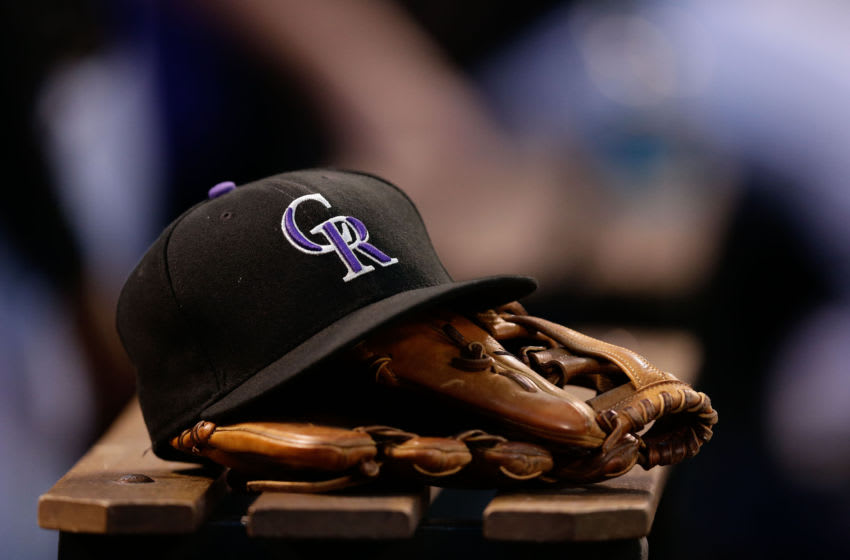 Jun 20, 2017; Denver, CO, USA; A general view of a Colorado Rockies hat and glove in the sixth inning of the game against the Arizona Diamondbacks at Coors Field. Mandatory Credit: Isaiah J. Downing-USA TODAY Sports