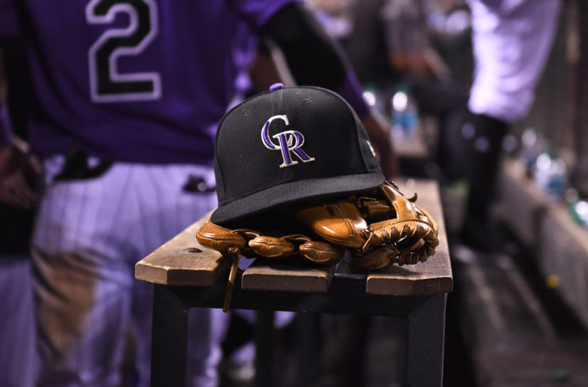 Aug 4, 2017; Denver, CO, USA; General view of the hat and glove of Colorado Rockies shortstop Pat Valaika (4) (not pictured) in the seventh inning against the Philadelphia Phillies at Coors Field. Mandatory Credit: Ron Chenoy-USA TODAY Sports