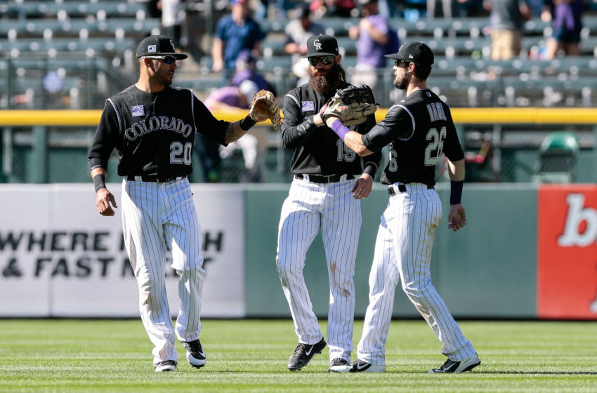 Apr 25, 2018; Denver, CO, USA; Colorado Rockies left fielder Ian Desmond (20) and center fielder Charlie Blackmon (19) and right fielder David Dahl (26) celebrate after the game against the San Diego Padres at Coors Field. Mandatory Credit: Isaiah J. Downing-USA TODAY Sports