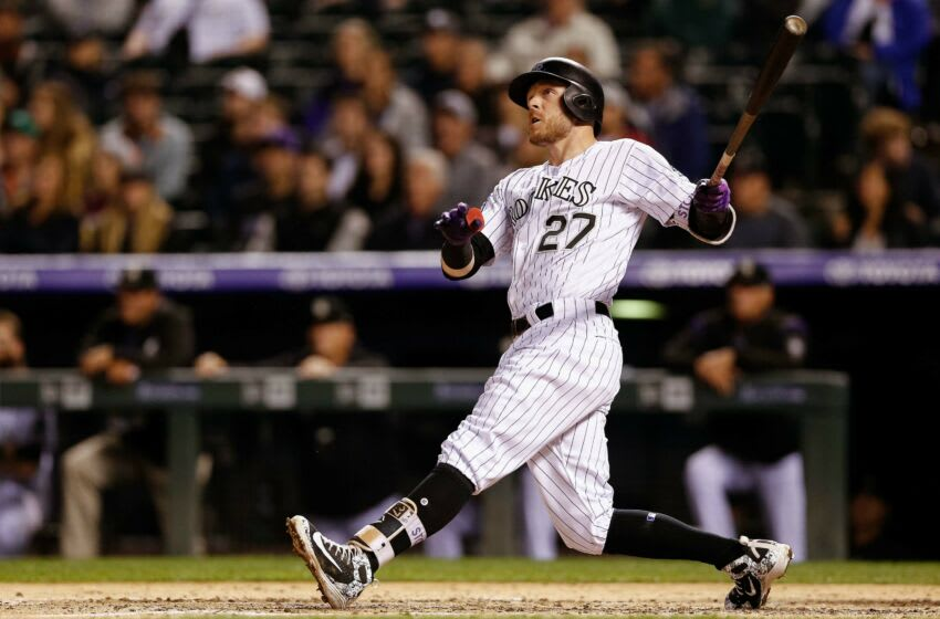 Sep 5, 2018; Denver, CO, USA; Colorado Rockies shortstop Trevor Story (27) watches his ball on a solo home run in the fourth inning against the San Francisco Giants at Coors Field. Mandatory Credit: Isaiah J. Downing-USA TODAY Sports