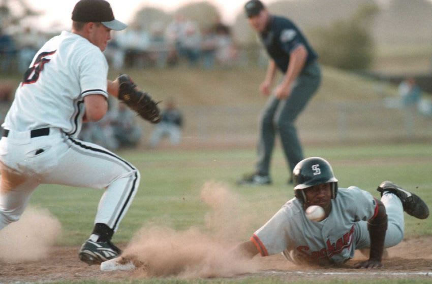 Spokane's Merrel Ligons dives back to first base before advancing on an errant pickoff attempt. for 1b No Title