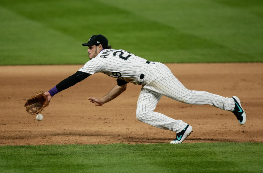 Aug 4, 2020; Denver, Colorado, USA; Colorado Rockies third baseman Nolan Arenado (28) is unable to field the ball in the eighth inning against the San Francisco Giants at Coors Field. Mandatory Credit: Isaiah J. Downing-USA TODAY Sports