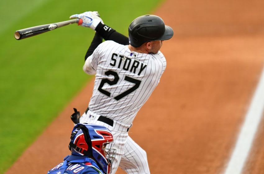 Aug 15, 2020; Denver, Colorado, USA; Colorado Rockies shortstop Trevor Story (27) triples in the first inning against the Texas Rangers at Coors Field. Mandatory Credit: Ron Chenoy-USA TODAY Sports