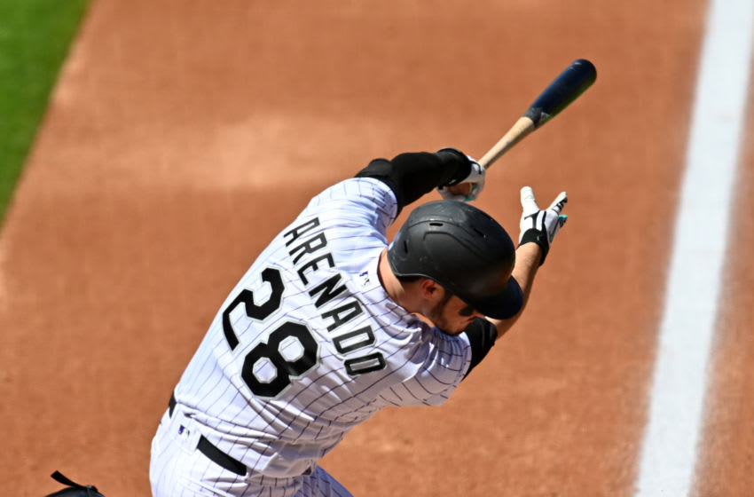 Sep 2, 2020; Denver, Colorado, USA; Colorado Rockies third baseman Nolan Arenado (28) singles in the first inning against the San Francisco Giants at Coors Field. Mandatory Credit: Ron Chenoy-USA TODAY Sports