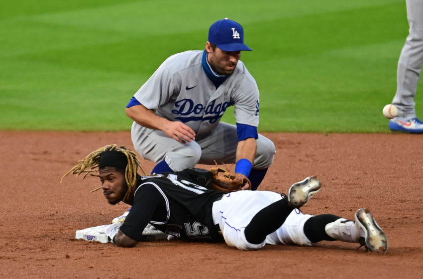Sep 19, 2020; Denver, Colorado, USA; Colorado Rockies left fielder Raimel Tapia (15) reaches second base as Los Angeles Dodgers short stop Chris Taylor (3) tags in the first inning at Coors Field. Mandatory Credit: Ron Chenoy-USA TODAY Sports
