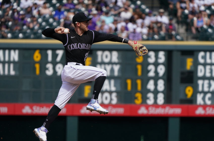 Apr 4, 2021; Denver, Colorado, USA; Colorado Rockies shortstop Trevor Story (27) fields the ball in the sixth inning against the against the Los Angeles Dodgers at Coors Field. Mandatory Credit: Ron Chenoy-USA TODAY Sports