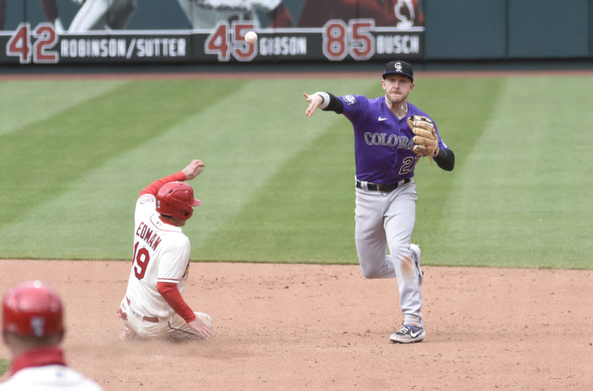 May 8, 2021; St. Louis, Missouri, USA; St. Louis Cardinals second baseman Tommy Edman (19) is out at seconds as Colorado Rockies shortstop Trevor Story (27) turns a double play in the sixth inning at Busch Stadium. Mandatory Credit: Joe Puetz-USA TODAY Sports