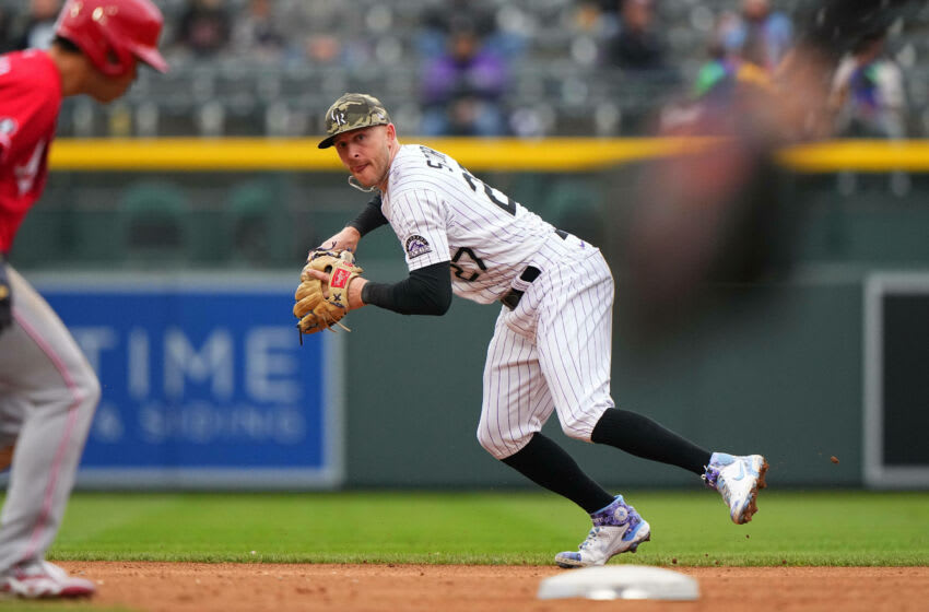 May 16, 2021; Denver, Colorado, USA; Colorado Rockies shortstop Trevor Story (27) fields the ball in the fifth inning against the Cincinnati Reds at Coors Field. Mandatory Credit: Ron Chenoy-USA TODAY Sports