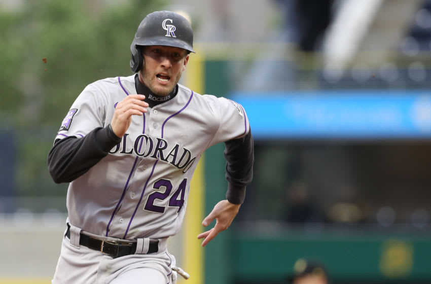 May 30, 2021; Pittsburgh, Pennsylvania, USA; Colorado Rockies second baseman Ryan McMahon (24) runs the bases on his way to scoring a run against the Pittsburgh Pirates during the ninth inning at PNC Park. Colorado won 4-3. Mandatory Credit: Charles LeClaire-USA TODAY Sports