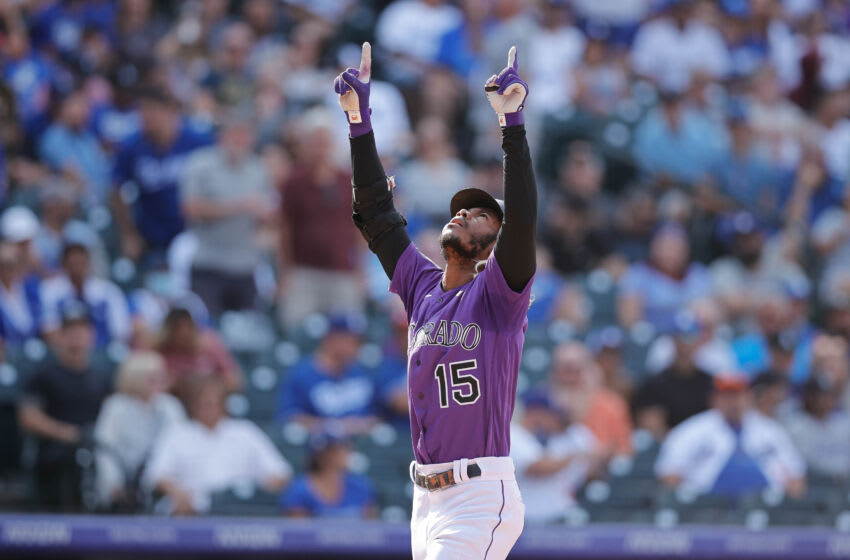 Sep 23, 2021; Denver, Colorado, USA; Colorado Rockies left fielder Raimel Tapia (15) celebrates a two run home run in the sixth inning against the Los Angeles Dodgers at Coors Field. Mandatory Credit: Isaiah J. Downing-USA TODAY Sports