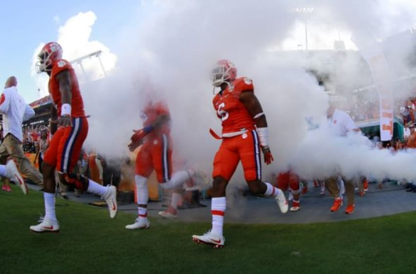 Dec 31, 2015; Miami Gardens, FL, USA; The Clemson Tigers run out for the start of the 2015 CFP Semifinal against the Oklahoma Sooners at the Orange Bowl at Sun Life Stadium. Mandatory Credit: Kim Klement-USA TODAY Sports