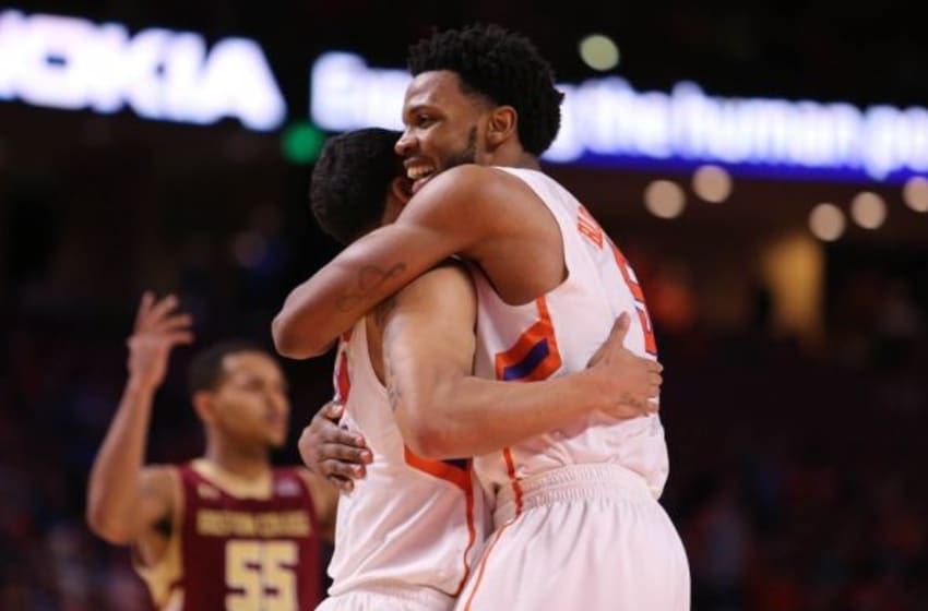 Feb 17, 2016; Greenville, SC, USA; Clemson Tigers forward Jaron Blossomgame (5) celebrates with guard Avry Holmes (12) after making a play against the Boston College Eagles during the second half at Bon Secours Wellness Arena. The Tigers won 65-54. Mandatory Credit: Dawson Powers-USA TODAY Sports