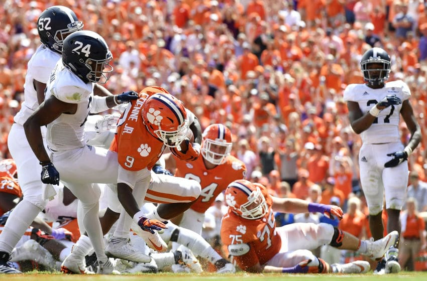 CLEMSON, SC - SEPTEMBER 15: Running back Travis Etienne #9 of the Clemson Tigers rushes for a touchdown against the Georgia Southern Eagles during the football game at Clemson Memorial Stadium on September 15, 2018 in Clemson, South Carolina. (Photo by Mike Comer/Getty Images)