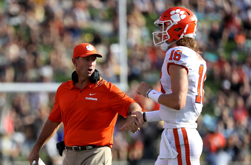 WINSTON SALEM, NC - OCTOBER 06: Head coach Dabo Swinney of the Clemson Tigers celebrates a touchdown with Trevor Lawrence #16 of the Clemson Tigers during their game at BB&T Field on October 6, 2018 in Winston Salem, North Carolina. (Photo by Streeter Lecka/Getty Images)