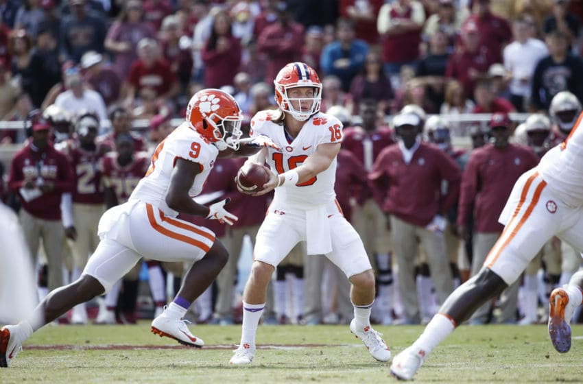 TALLAHASSEE, FL - OCTOBER 27: Trevor Lawrence #16 of the Clemson Tigers looks to hand off to Travis Etienne #9 during the game against the Florida State Seminoles at Doak Campbell Stadium on October 27, 2018 in Tallahassee, Florida. Clemson won 59-10. (Photo by Joe Robbins/Getty Images)