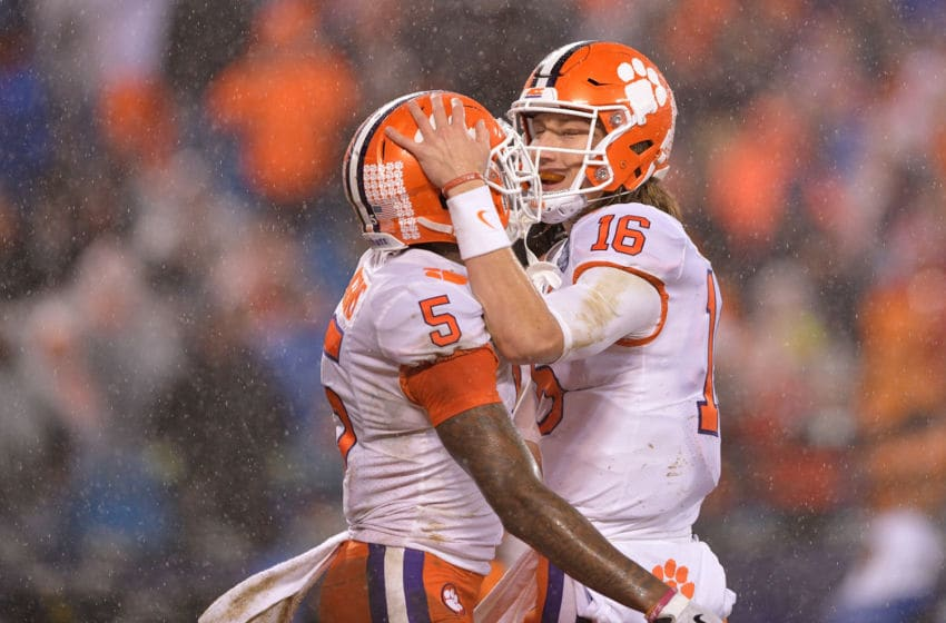 CHARLOTTE, NC - DECEMBER 01: Tee Higgins #5 celebrates with Trevor Lawrence #16 of the Clemson Tigers after scoring a touchdown against the Pittsburgh Panthers during the second quarter of their game at Bank of America Stadium on December 1, 2018 in Charlotte, North Carolina. (Photo by Grant Halverson/Getty Images)
