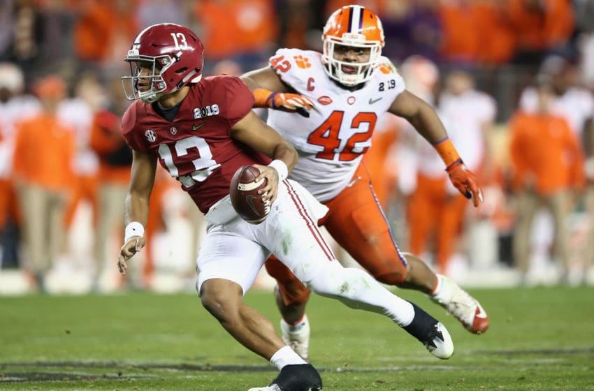 SANTA CLARA, CA - JANUARY 07: Tua Tagovailoa #13 of the Alabama Crimson Tide is pursued by Christian Wilkins #42 of the Clemson Tigers during the second half in the CFP National Championship presented by AT&T at Levi's Stadium on January 7, 2019 in Santa Clara, California. (Photo by Ezra Shaw/Getty Images)