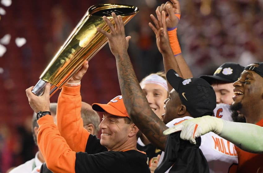 SANTA CLARA, CA - JANUARY 07: Head coach Dabo Swinney of the Clemson Tigers celebrates his teams 44-16 win over the Alabama Crimson Tide with the trophy in the CFP National Championship presented by AT&T at Levi's Stadium on January 7, 2019 in Santa Clara, California. (Photo by Harry How/Getty Images)