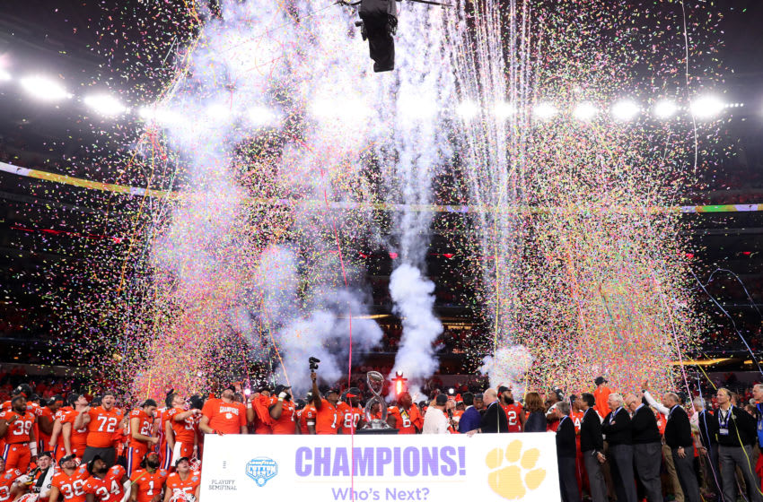 ARLINGTON, TEXAS - DECEMBER 29: The Clemson Tigers celebrate with the trophy after defeating the Notre Dame Fighting Irish during the College Football Playoff Semifinal Goodyear Cotton Bowl Classic at AT&T Stadium on December 29, 2018 in Arlington, Texas. Clemson defeated Notre Dame 30-3. (Photo by Tom Pennington/Getty Images)