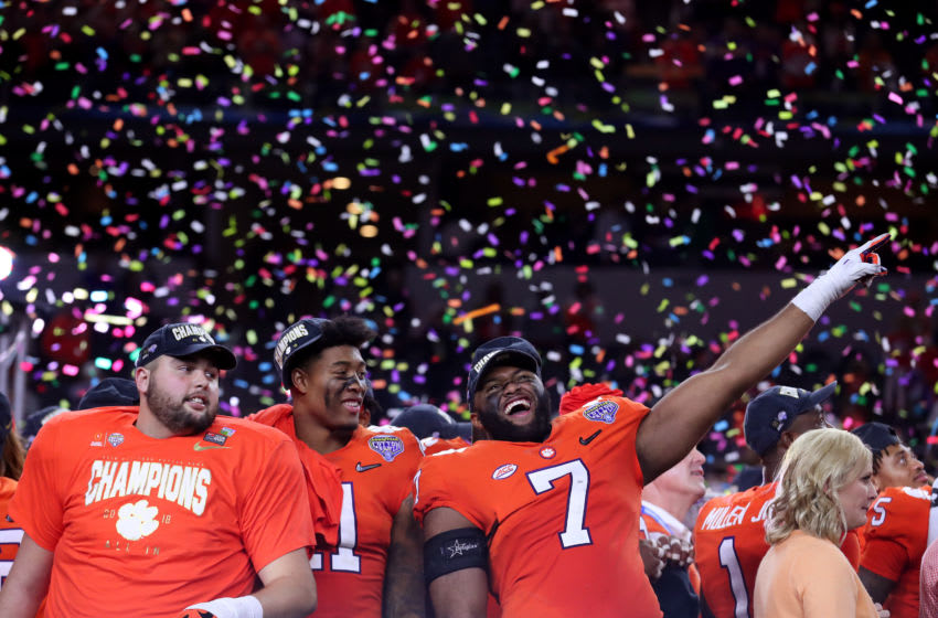 ARLINGTON, TEXAS - DECEMBER 29: Austin Bryant #7 of the Clemson Tigers celebrates with teammates after defeating the Notre Dame Fighting Irish during the College Football Playoff Semifinal Goodyear Cotton Bowl Classic at AT&T Stadium on December 29, 2018 in Arlington, Texas. Clemson defeated Notre Dame 30-3. (Photo by Tom Pennington/Getty Images)