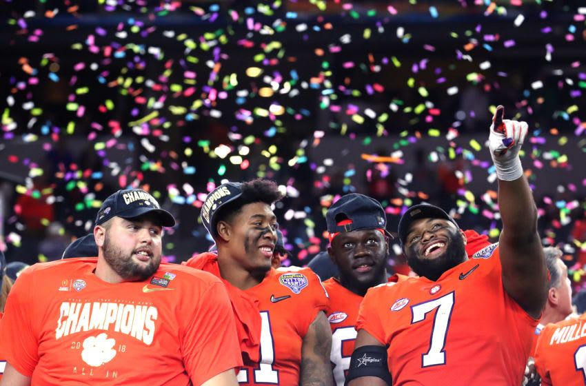 ARLINGTON, TEXAS - DECEMBER 29: Isaiah Simmons #11 and Austin Bryant #7 of the Clemson Tigers celebrate after defeating the Notre Dame Fighting Irish during the College Football Playoff Semifinal Goodyear Cotton Bowl Classic at AT&T Stadium on December 29, 2018 in Arlington, Texas. Clemson defeated Notre Dame 30-3. (Photo by Kevin C. Cox/Getty Images)