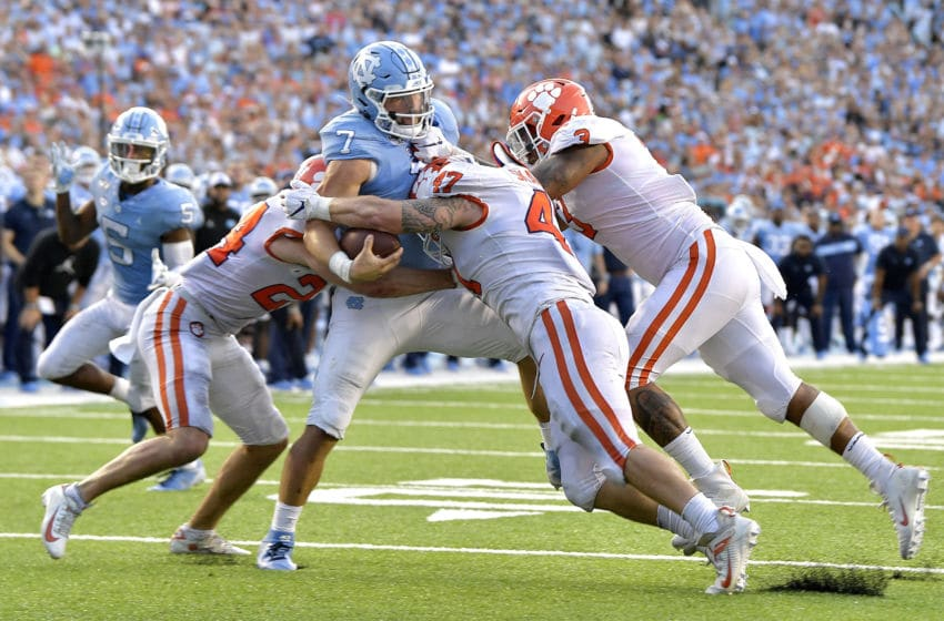 CHAPEL HILL, NORTH CAROLINA - SEPTEMBER 28: Nolan Turner #24, James Skalski #47 and Xavier Thomas #3 of the Clemson Tigers stop Sam Howell #7 of the North Carolina Tar Heels short of the goal line on a two-point conversion in the final minute of the fourth quarter at Kenan Stadium on September 28, 2019 in Chapel Hill, North Carolina. Clemson won 21-20. (Photo by Grant Halverson/Getty Images)