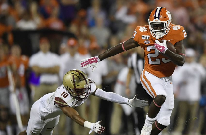 CLEMSON, SOUTH CAROLINA - OCTOBER 26: Running back Lyn-J Dixon #23 of the Clemson Tigers evades defensive back Brandon Sebastian #10 of the Boston College Eagles during their football game at Memorial Stadium on October 26, 2019 in Clemson, South Carolina. (Photo by Mike Comer/Getty Images)